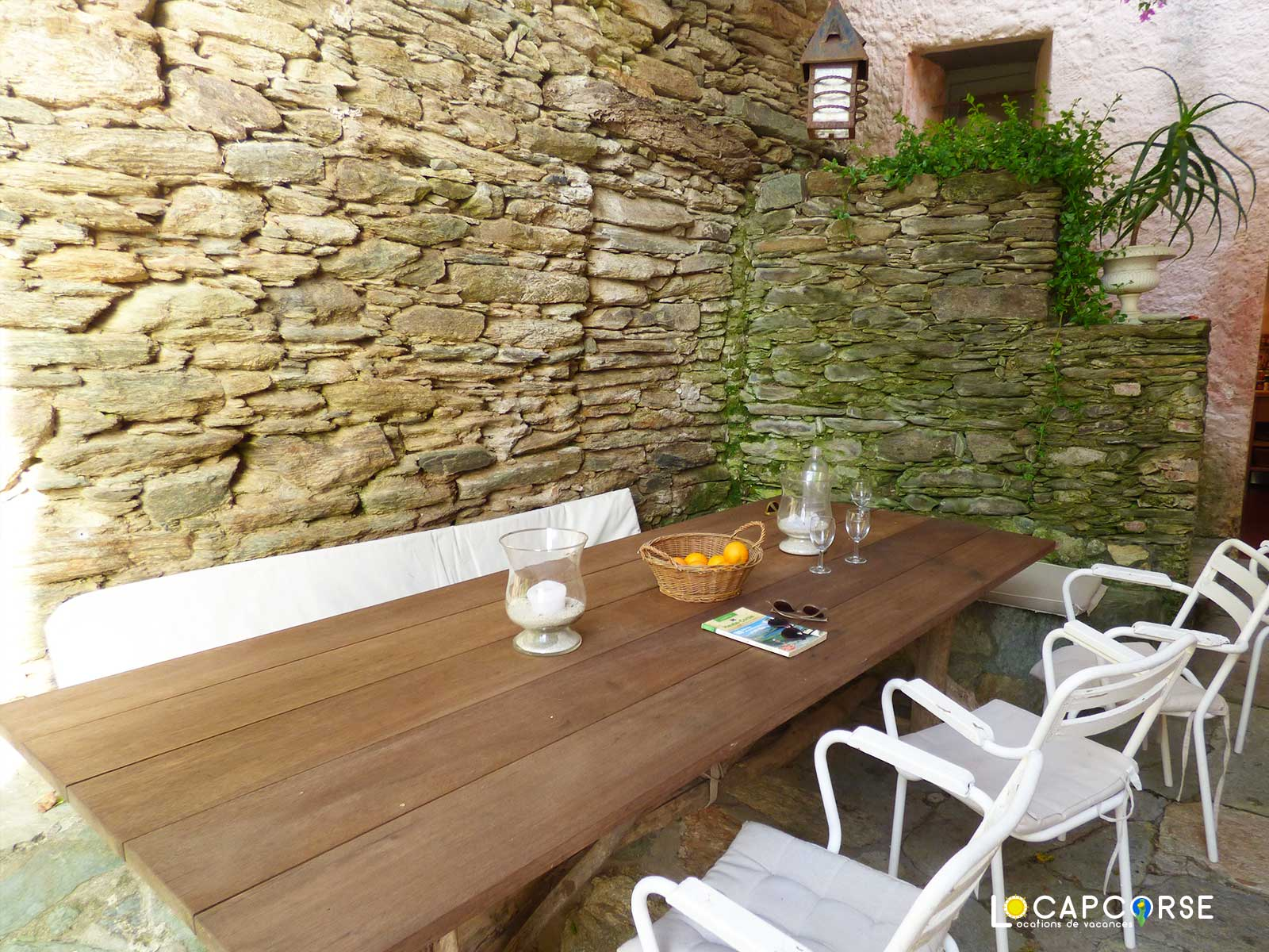 Locations Cap Corse - The other dining area behind the house with the door giving direct access to the kitchen